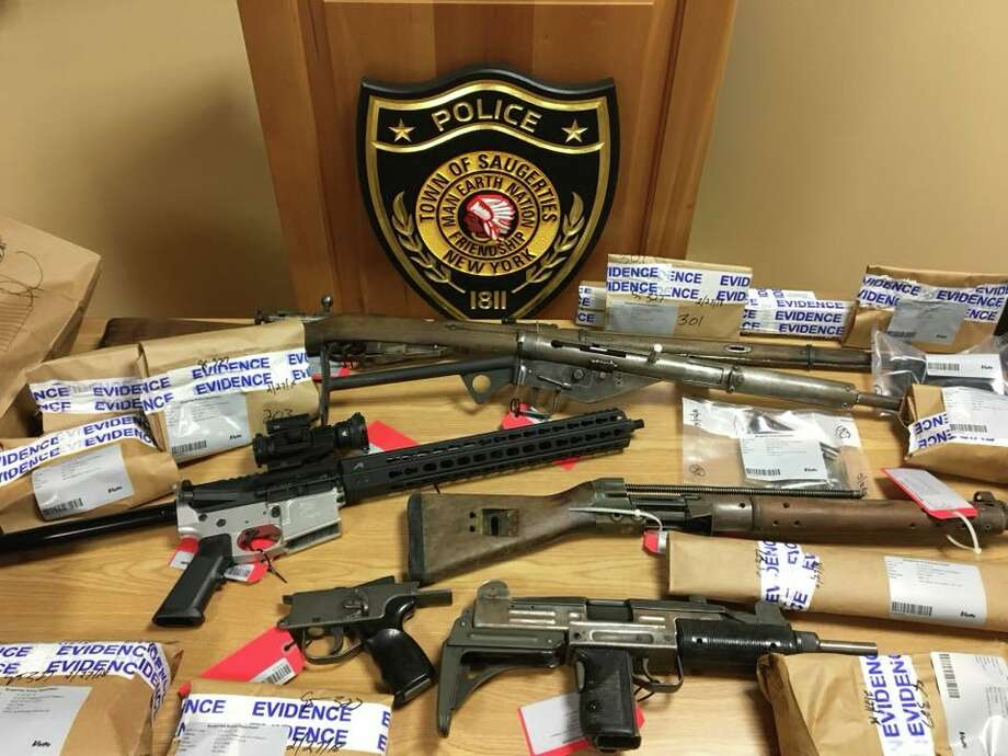 Police seized the firearms and parts from Connor and Bruce Chargois after a threatening social media post. Photo: Saugerties Police