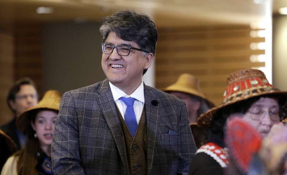 Author and filmmaker Sherman Alexie waits with dancers backstage for his turn on stage as the keynote speaker at a celebration of Indigenous Peoples Day Monday, Oct. 10, 2016, at Seattle's City Hall. Photo: Elaine Thompson/AP