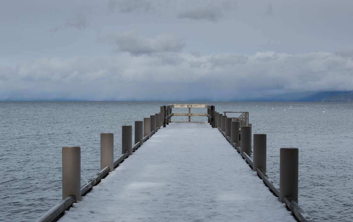 SOUTH LAKE TAHOE, CA - JANUARY 22: A fast-moving snowstorm moves into the mountains and the lake on January 22, 2018, in South Lake Tahoe, California. Though a six-year drought in California and Nevada was called off last year following record rain and up to 25 feet of snow in the Sierra Nevada Mountain Range, this year's snowfall levels compared to last have been dismal. (Photo by George Rose/Getty Images)