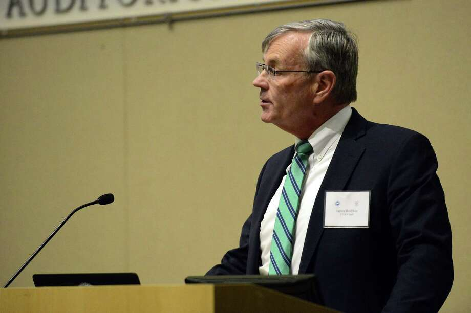 James Redeker, Commissioner of Connecticut Department of Transportation, address commuters, elected officials and residents during a public hearing, the fourth in a series of seven, by Connecticut Department of Transportation on Tuesday, Feb. 27, 2018 at UConn/Stamford's GenRe Auditorium in Stamford, Connecticut. The purpose of the meeting was to gather input on proposed bus and rail fare increases and service reductions to the New Canaan, Danbury and Waterbury branch lines on the New Haven Line, and on Shore Line East. Photo: Matthew Brown / Hearst Connecticut Media / Stamford Advocate