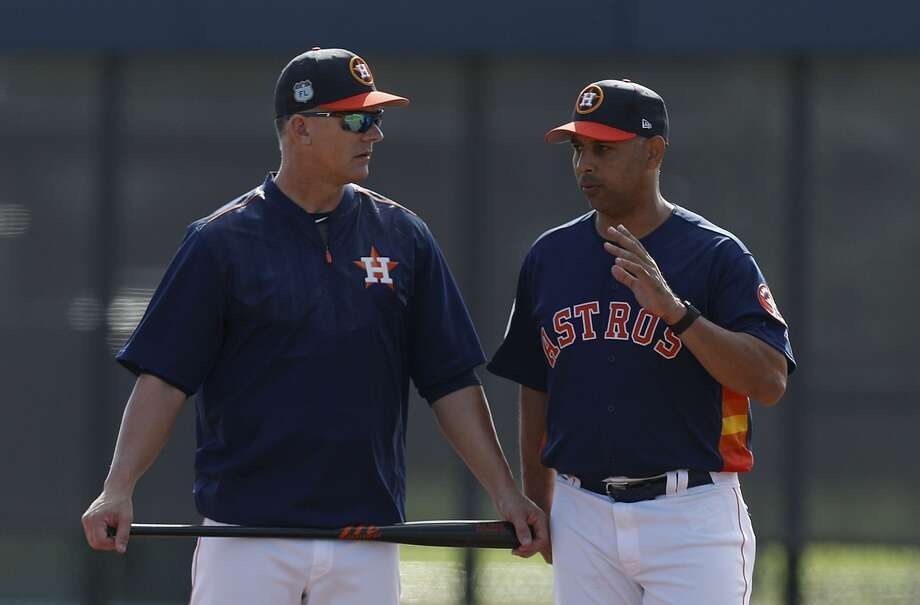 Houston Astros manager A.J. Hinch and bench coach Alex Cora talk during spring training at The Ballpark of the Palm Beaches, in West Palm Beach, Florida, Friday, February 24, 2017. ( Karen Warren / Houston Chronicle ) Photo: Karen Warren/Houston Chronicle