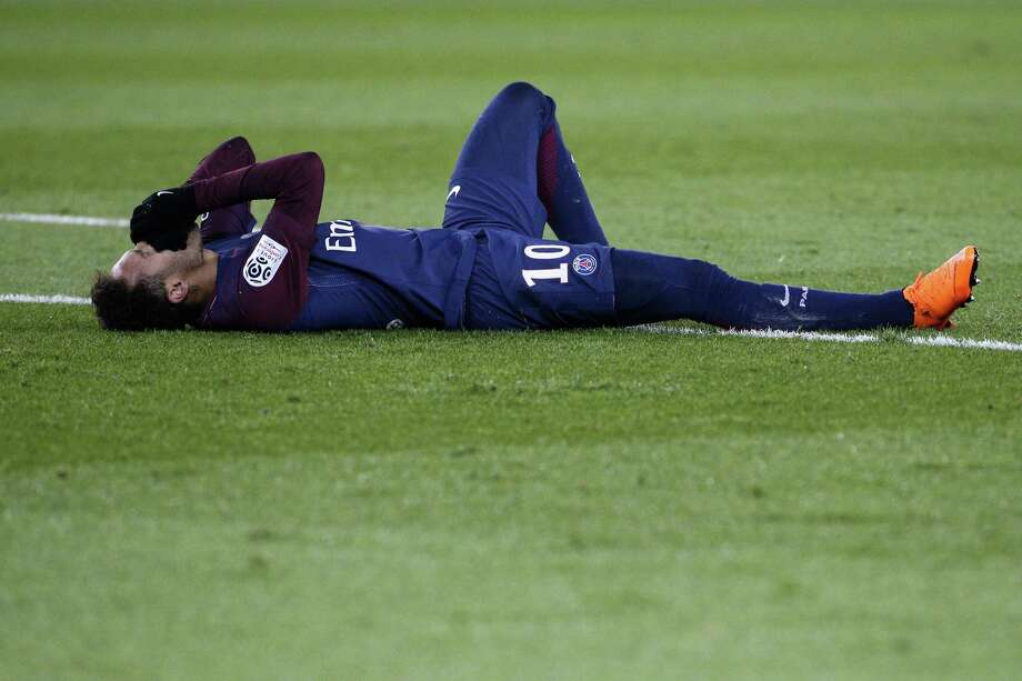 TOPSHOT - Paris Saint-Germain's Brazilian forward Neymar Jr reacts lying on the pitch during the French L1 football match between Paris Saint-Germain (PSG) and Marseille (OM) at the Parc des Princes in Paris on February 25, 2018.  / AFP PHOTO / GEOFFROY VAN DER HASSELTGEOFFROY VAN DER HASSELT/AFP/Getty Images Photo: GEOFFROY VAN DER HASSELT, AFP/Getty Images / AFP or licensors