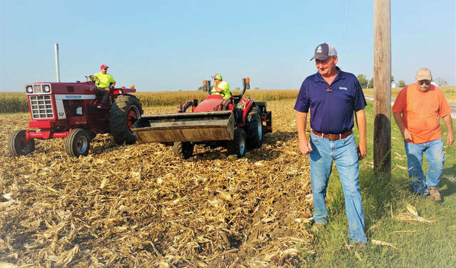 Brent Hunsche, Travis Eilers, Cliff Schuette and Ted Krauskopf plant a variety of cover crops into the Field Day demo plot at the Hunsche Farm in Highland. Photo: For The Telegraph