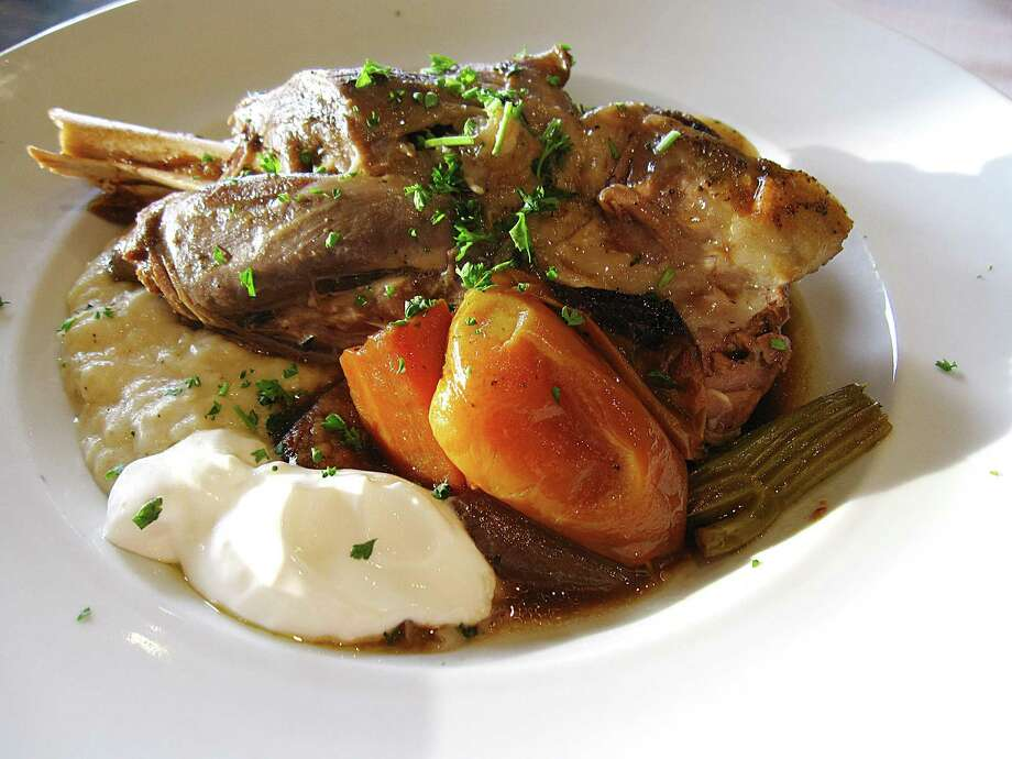 Lamb shank with eggplant puree and yogurt sauce from Basil Mediterranean Kitchen. Photo: Mike Sutter /San Antonio Express-News