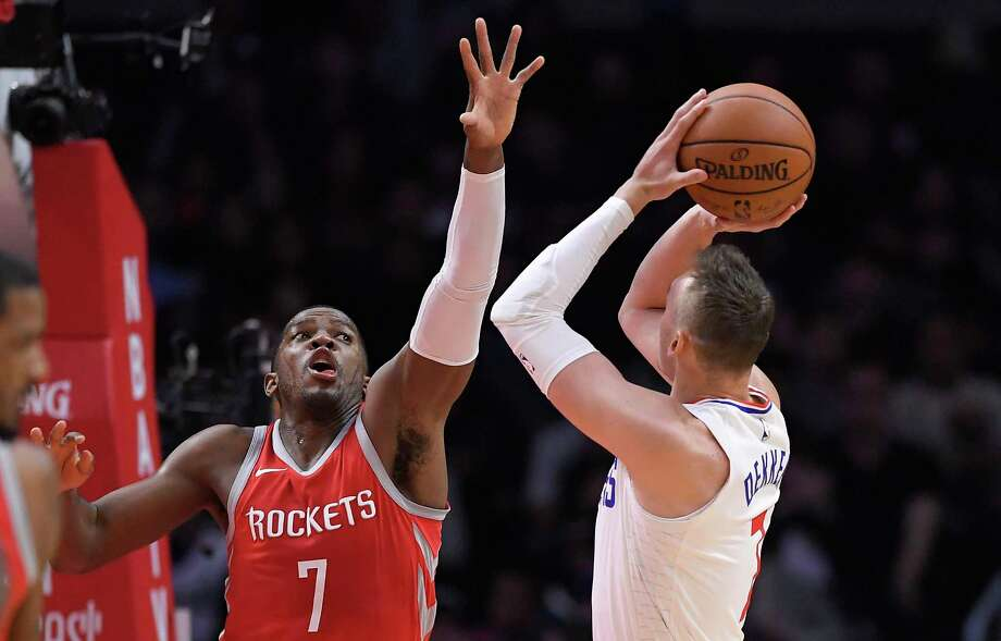 Los Angeles Clippers forward Sam Dekker, right, shoots as Houston Rockets guard Joe Johnson defends during the second half of an NBA basketball game Wednesday, Feb. 28, 2018, in Los Angeles. The Rockets won 105-92. (AP Photo/Mark J. Terrill) Photo: Mark J. Terrill, Associated Press / Copyright 2018 The Associated Press. All rights reserved.