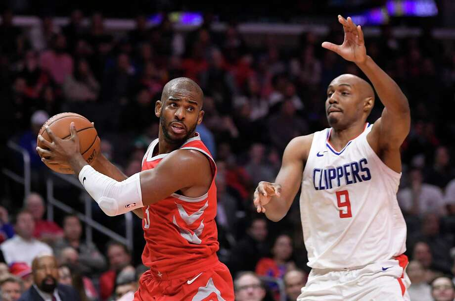 Houston Rockets guard Chris Paul, left, tries to pass while under pressure from Los Angeles Clippers guard C.J. Williams during the second half of an NBA basketball game Wednesday, Feb. 28, 2018, in Los Angeles. The Rockets won 105-92. (AP Photo/Mark J. Terrill) Photo: Mark J. Terrill, Associated Press / Copyright 2018 The Associated Press. All rights reserved.