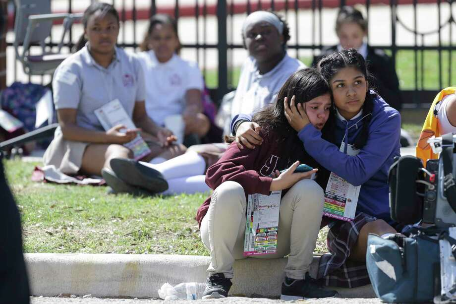 Students are evacuated at Young Women's College Preparatory Academy, 1906 Clebuene St., shown Thursday, March 1, 2017. Photo: Melissa Phillip, Houston Chronicle