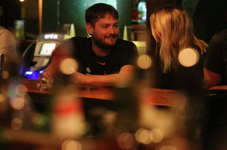 PHOTOS: The Harp signs off on Richmond, again Will Shropshire and Nicole Witt have a conversation at the bar on The Harp's closing night on Wednesday, Feb. 28, 2018, in Houston. >>>See how bar patrons said goodbye to a chapter in the bar's life in February... Photo: Yi-Chin Lee, Houston Chronicle / © 2018 Houston Chronicle