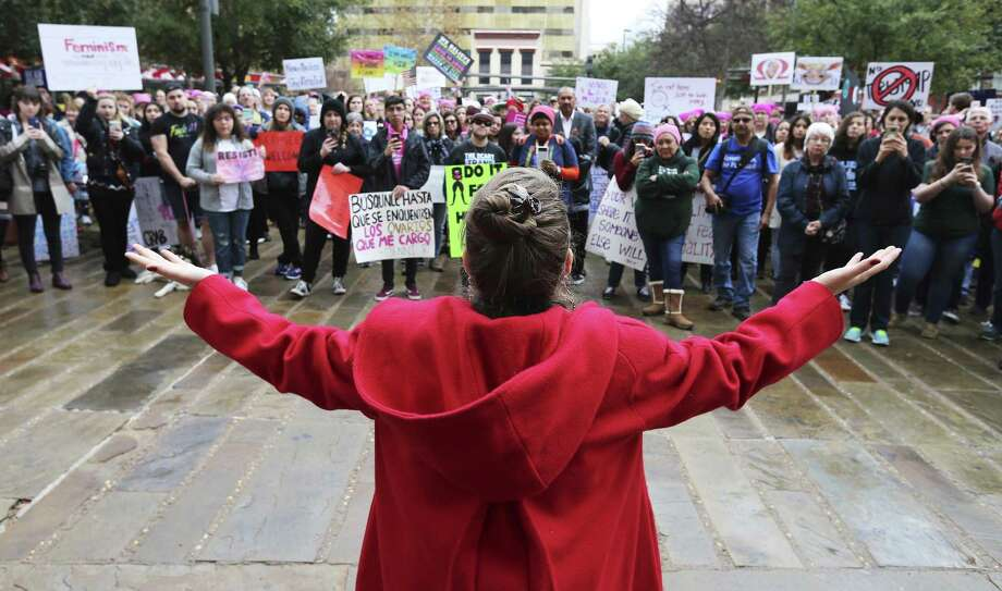 "Performance artist Jessica Tilton Zertuche raises her arms while reciting her poetry of empowerment to about 500 people according to organizers gathered at Main Plaza to take part in the second annual Women's Rally on Saturday, Jan. 20, 2018. The message of the event hosted by TX23 Indivisible, was clear and decisive as speaker after speaker implored those in attendance that women's voices were not be silenced and to vote in upcoming elections. ""When women vote, we win,"" said Cassandra Littlejohn, Bexar County Democratic Party Political Director. Toward the end of the two-hour rally, a brief march around Main Plaza came together as the event concluded. (Kin Man Hui/San Antonio Express-News) Photo: Kin Man Hui, Staff / San Antonio Express-News / ©2018 San Antonio Express-News"