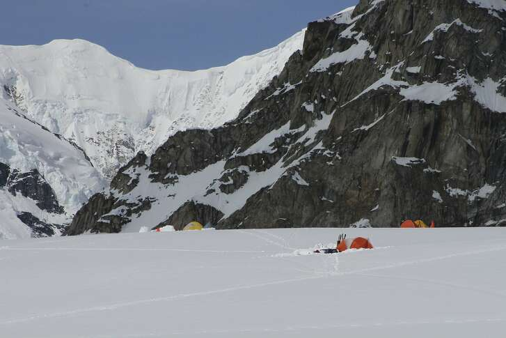 FILE - This file April 24, 2016 file photo taken on the Kahiltna Glacier in Alaska, shows a few tents occupied by early season climbers near Denali in the Alaska Range. The National Park Service is considering revised rules for climbers that would require human waste to be deposited in a crevasse at 14,200 feet or at the Talkeetna, Alaska, ranger station. Current rules allow climbers below 15,000 feet to deposit waste into other deep crevasses but research indicates the glacier at lower elevations may not render it inert. (AP Photo/Mark Thiessen, file)