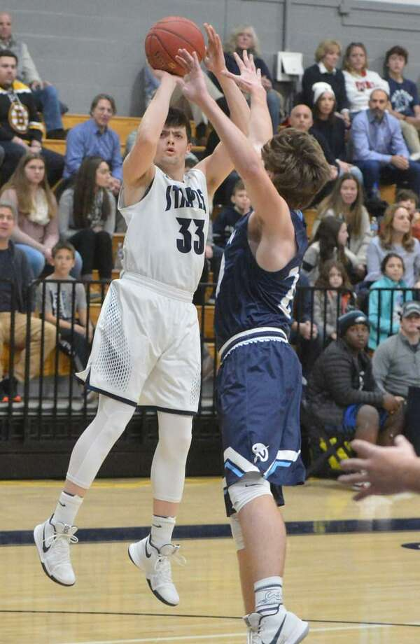Staples senior Max Sussman rises up against Wilton earlier this season. Sussman was named to the All-FCIAC third team this week. Photo: Alex Von Kleydorff / Hearst Connectict Media
