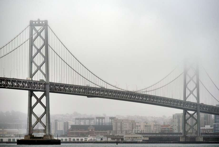 File photo: Fog and clouds hang over the Bay Bridge in San Francisco: Cloud cover is in the forecast through May 20. Photo: Michael Short, Special To The Chronicle