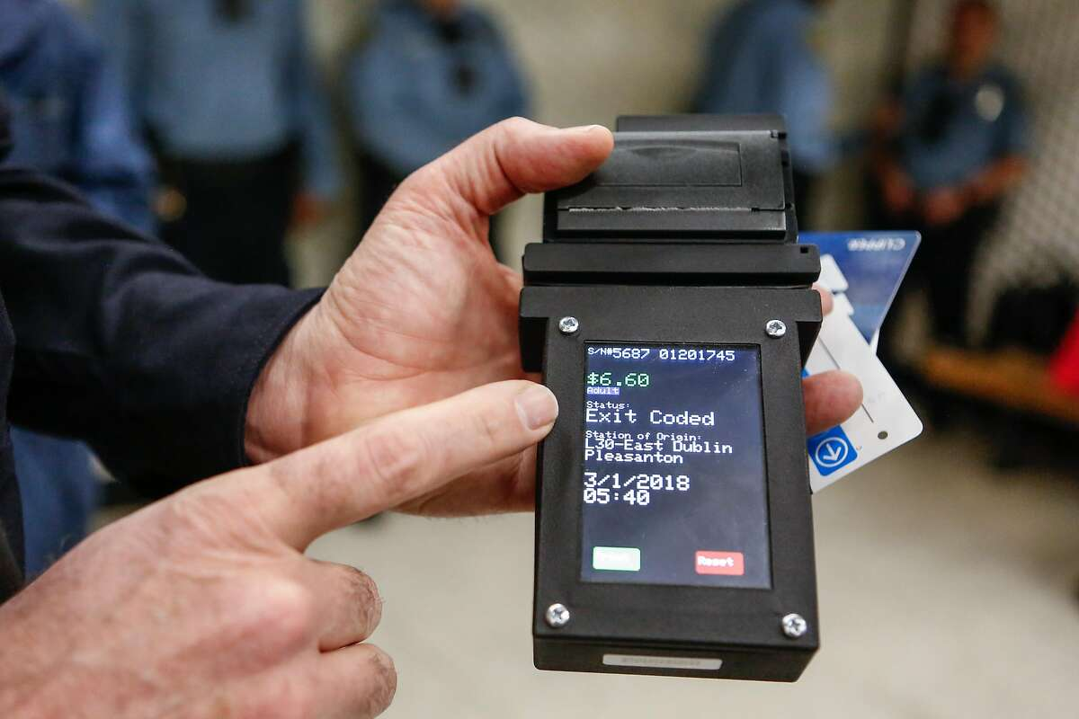 Deputy Chief of Police, Lance Haight, demostrates the new ticket/clipper card reader during a press conference at Powell Station on Thursday, February 28, 2018 in San Francisco, California.
