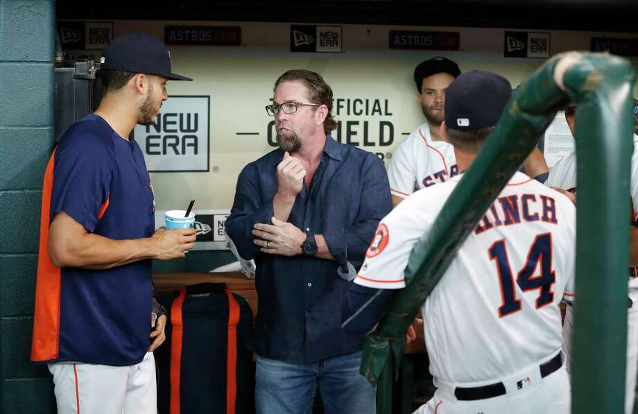 Houston Astros Carlos Correa chats with Jeff Bagwell in the dugout before a ceremony to honor Bagwell's recent induction into the National Baseball Hall of Fame before the start of an MLB game at Minute Maid Park, Saturday, Aug. 5, 2017, in Houston. ( Karen Warren / Houston Chronicle ) Photo: Karen Warren, Staff Photographer / @ 2017 Houston Chronicle