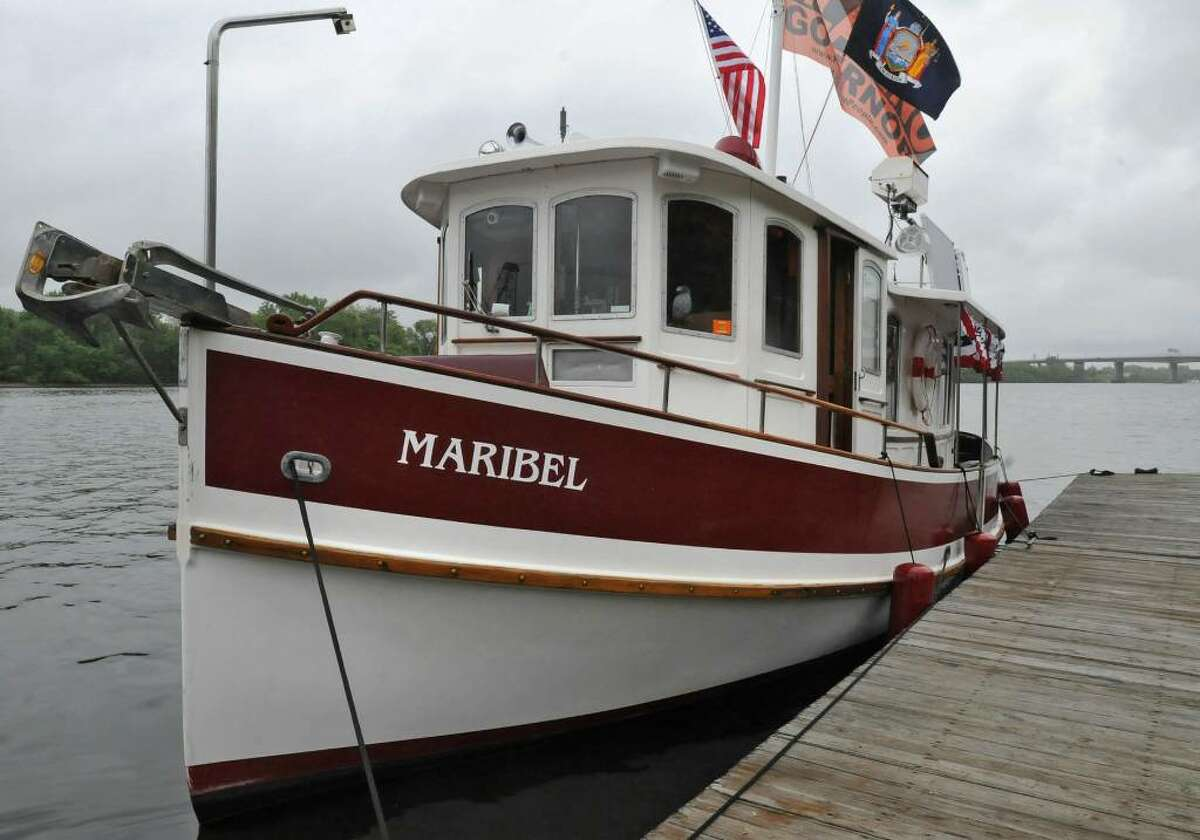 The trawler Maribel is ready for its canal trip Wednesday at the Corning Preserve, with flags flying, including a Mad as Hell banner. (Lori Van Buren / Times Union)
