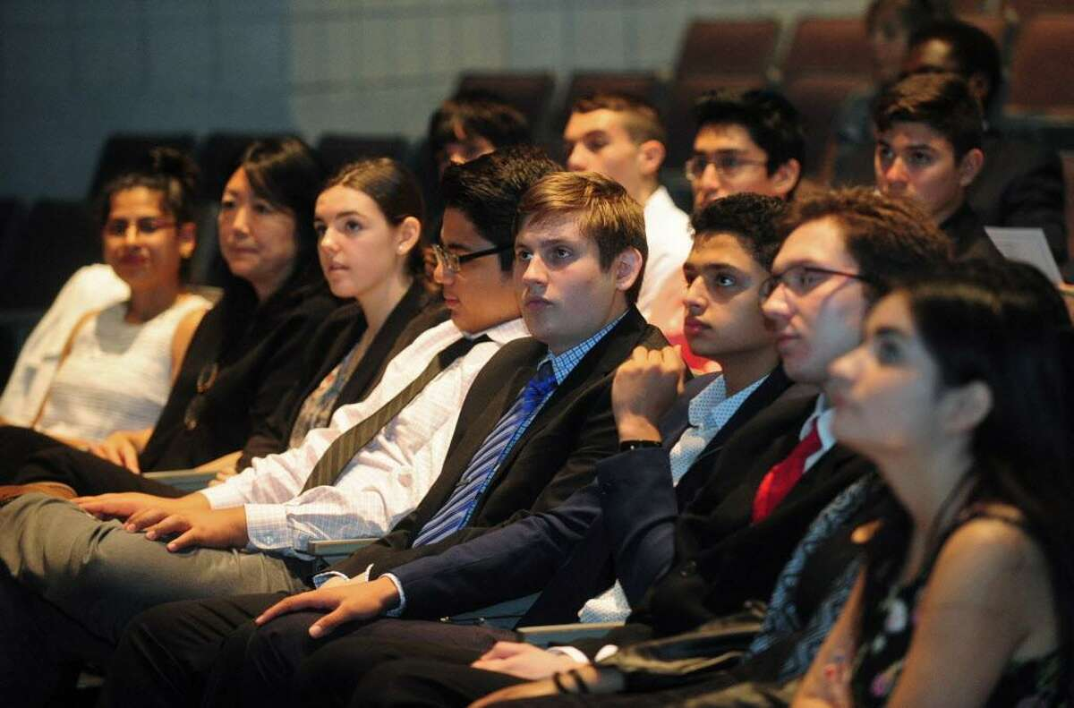 Norwalk Early College Academy (NECA) scholars who are working in paid internships at IBM lsiten to the guest speakers before giving their presentations during the IBM Internship Expo Friday, August 4, 2017, at The Norwalk Community College in Norwalk, Conn. NECA is Connecticut's first Pathways to Technology (P-TECH) institution for students in grades 9-14. The academy was jointly founded in August 2014 by IBM, Norwalk Community College, and Norwalk High School.