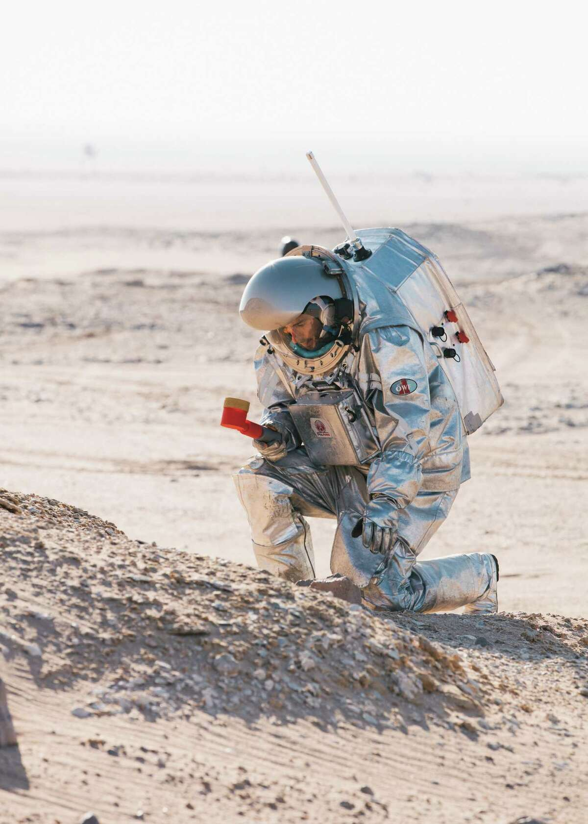 Analog astronaut Joao Lousada takes a geological sample using a 3D printed, modular, scoop as part of a scientific expedition outside the habitat.