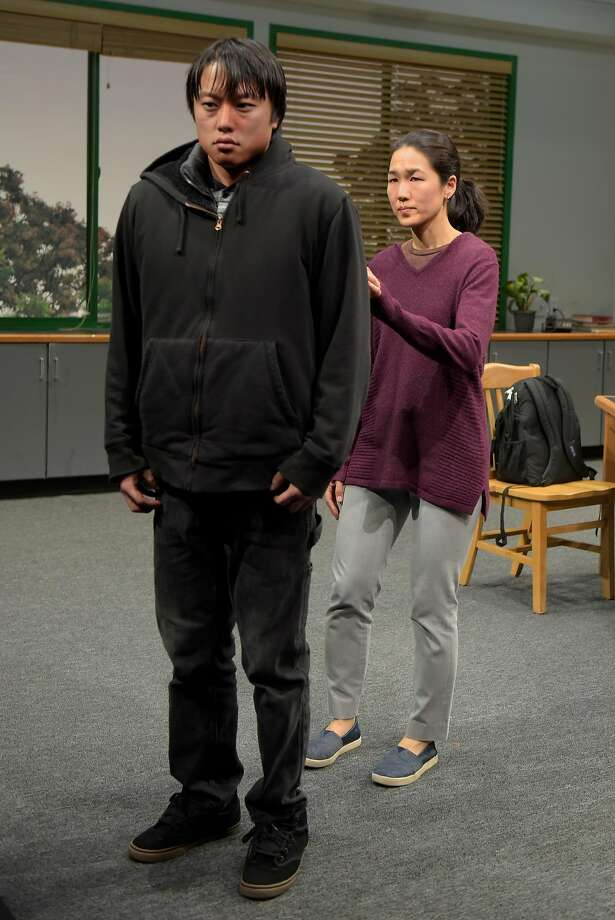 "Daniel Chung as Dennis and Jackie Chung as Gina in ""Office Hour."" Photo: Kevin Berne, Berkeley Repertory Theatre"