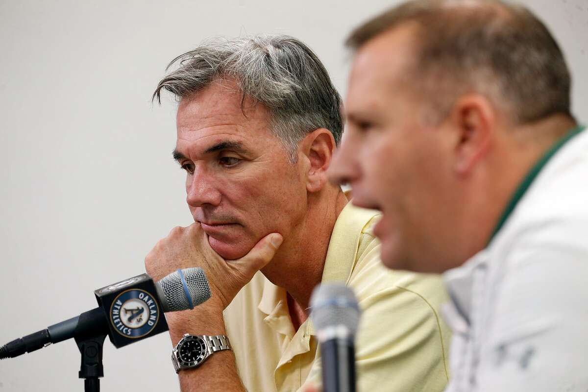 Oakland Athletics' VP of baseball operations Billy Beane, (left) and general manager David Forst talk about the baseball season during a press conference at the Oakland Coliseum on Mon. Oct. 2, 2017, in Oakland, Ca.