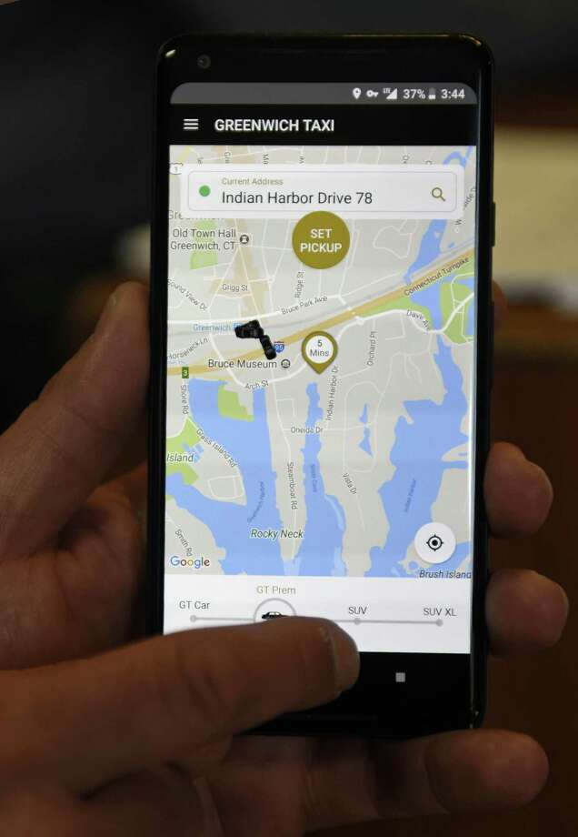 Greenwich Taxi IT Manager Angelo Siconolfi demostrates the new Greenwich Taxi mobile app at the Greenwich Taxi office at Greenwich Plaza in Greenwich, Conn. Tuesday, Feb. 27, 2018. Greenwich Taxi has made technological improvements and implemented a mobile app in an effort to compete with rideshare companies like Uber and Lyft. Photo: Tyler Sizemore / Hearst Connecticut Media / Greenwich Time
