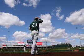 MESA, AZ - FEBRUARY 28:  Matt Joyce #23 of the Oakland Athletics walks out onto the field during the third inning of the spring training game against the Chicago Cubs at Sloan Park on February 28, 2018 in Mesa, Arizona.  (Photo by Christian Petersen/Getty Images)