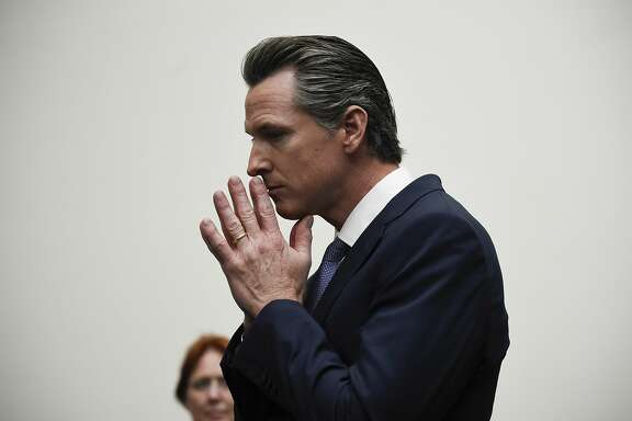 Democratic gubernatorial candidate Gavin Newsom listens to a question while speaking with delegates at the 2018 California Democrats State Convention Saturday, Feb. 24, 2018, in San Diego. (AP Photo/Denis Poroy)