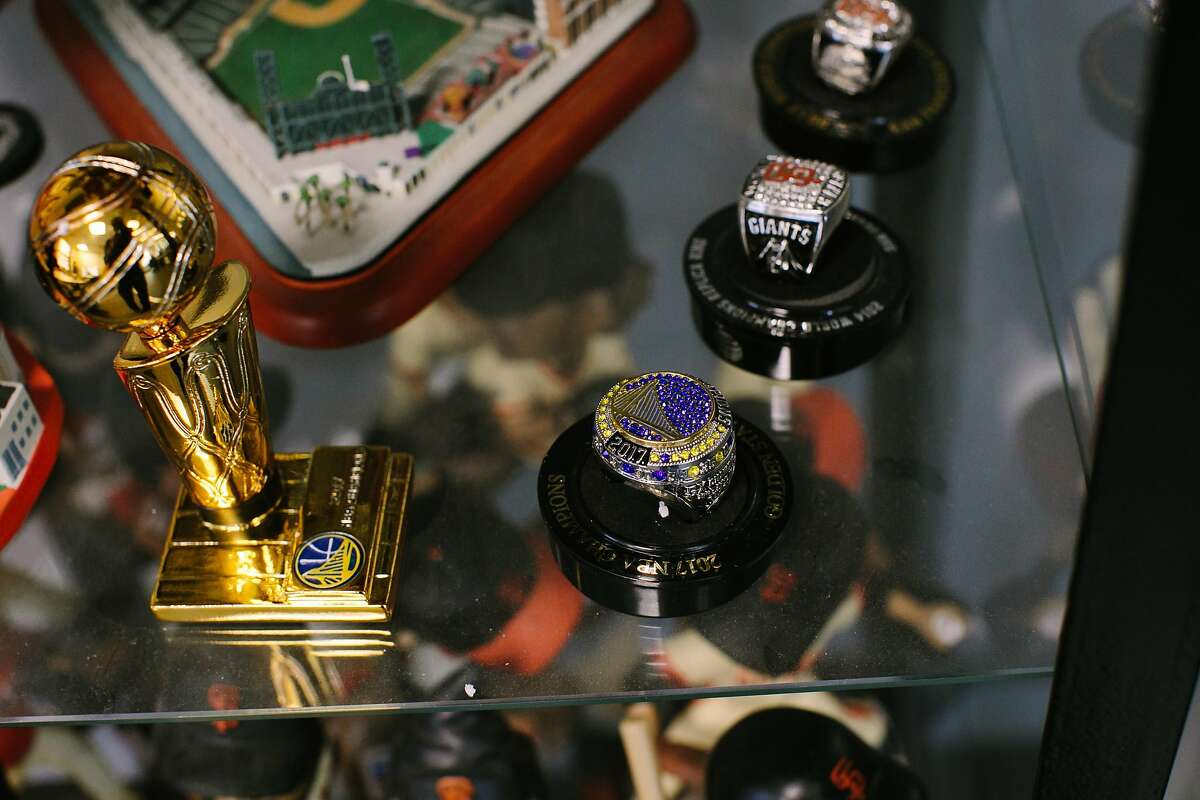 David L. Smith, collection of Warriors and Giants championship rings at his office at the Mediasmith in San Francisco, Calif., Thursday, March 1, 2018.