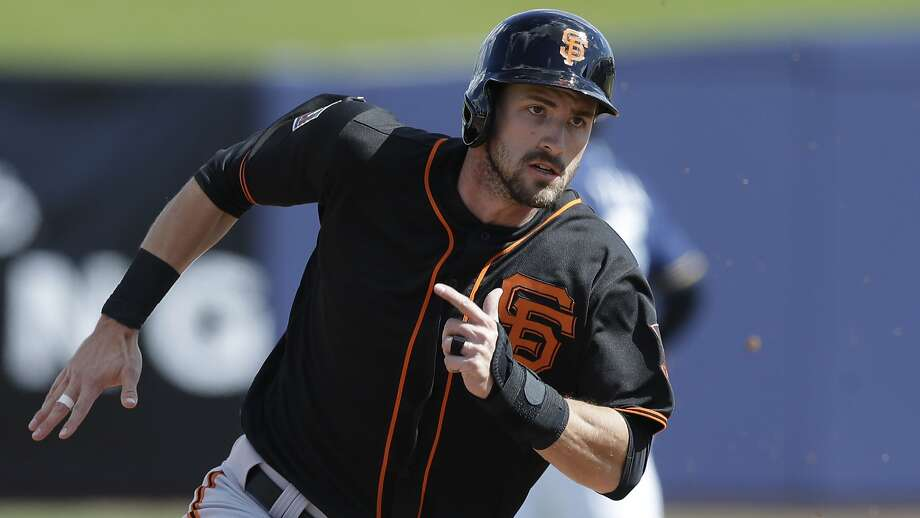 San Francisco Giants' Steven Duggar heads to third from first on a single by Brandon Crawford during the third inning of a spring training baseball game against the Milwaukee Brewers, Wednesday, Feb. 28, 2018, in Maryvale, Ariz.  Photo: Carlos Osorio, Associated Press