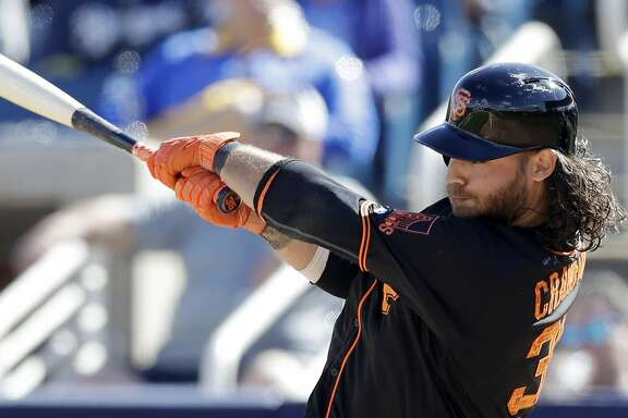 San Francisco Giants' Brandon Crawford bats during a spring training baseball game, Wednesday, Feb. 28, 2018, in Maryvale, Ariz. (AP Photo/Carlos Osorio)