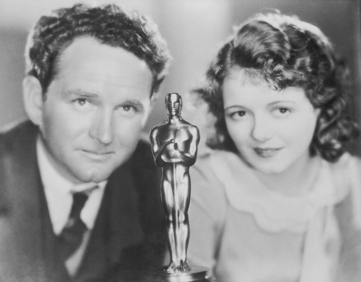 Janet Gaynor and Frank Borzage with an Academy Award in the foreground, center. Janet Gaynor won the first Oscar for Best Actress for her work in