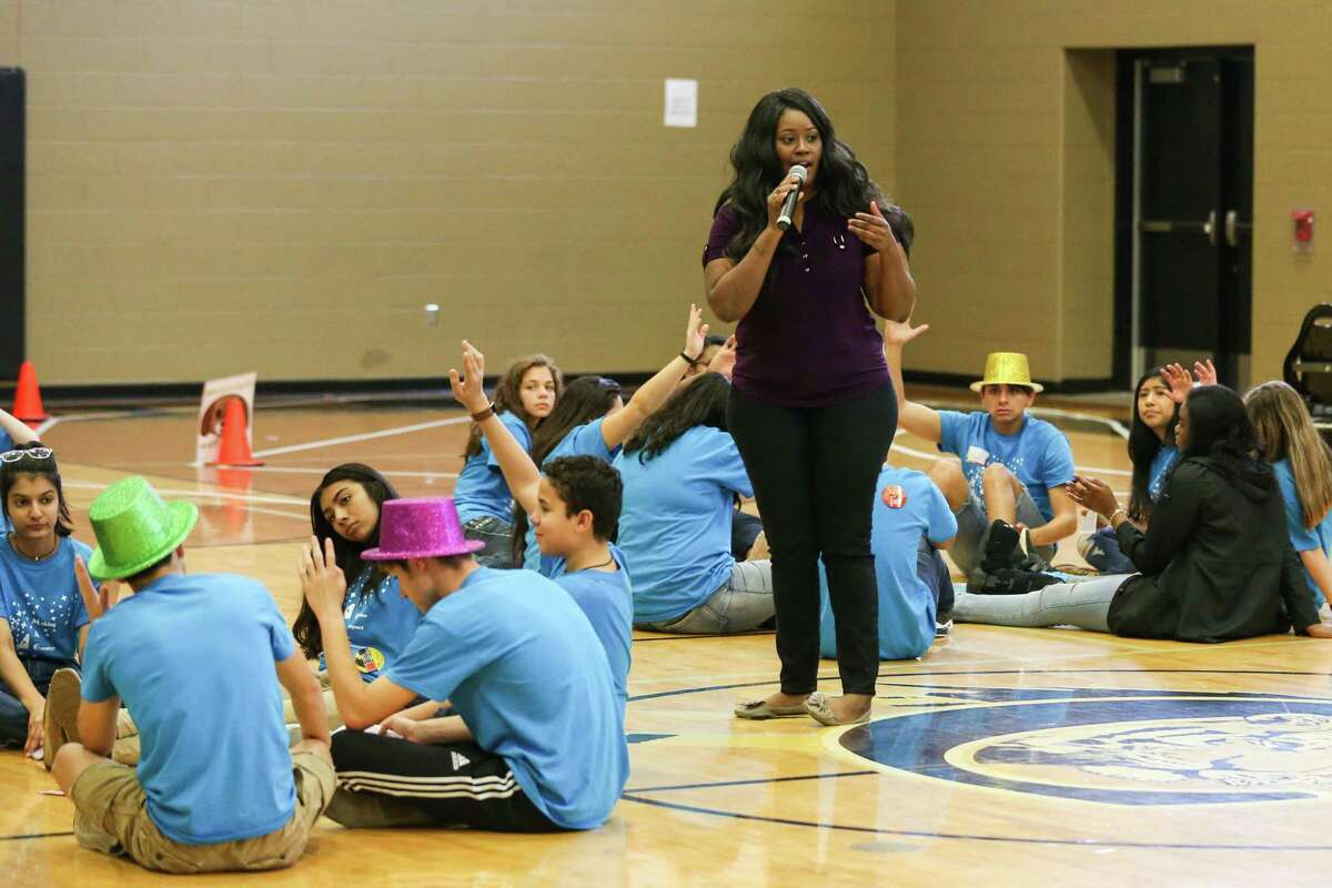 Quin'Tara Spencer, youth coordinator for United Against Human Trafficking, speaks to more than 140 students from Conroe, Tomball, Caney Creek and Oak Ridge High Schools on Friday at the Conroe High School 9th Grade Campus.