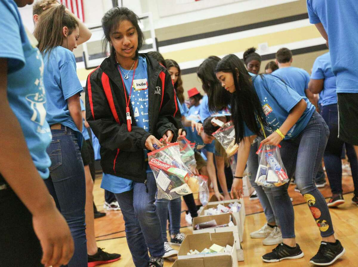 Tomball High School freshman Anuska Santra helps put together care packages for people rescued from human trafficking or homeless during a community service project on Friday, Feb. 16, 2018, at the Conroe High School 9th Grade Campus.