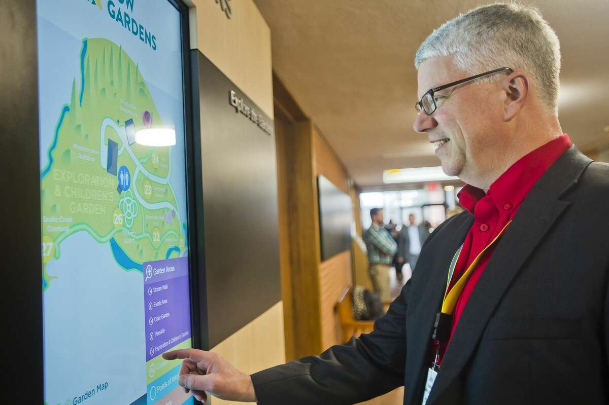 John Harken, a Midland Chamber of Commerce ambassador, checks out an interactive map inside the visitor center at Dow Gardens during a ribbon cutting event on Thursday, March 1, 2018. The event marked the end of a three-year renovation project at the visitor center. (Katy Kildee/kkildee@mdn.net)