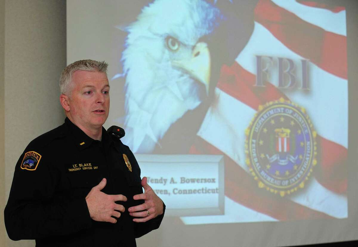 Lieutenant Terry Blake of The Norwalk Police Department hosts a presentation on human trafficking Thursday, March 1, 2018, conducted by FBI Special Agent Wendy Bowersox in the Police Department Community Room in Norwalk, Conn. The department invited local hotel owners and their staff for the comprehensive overview enabling them to better identify the signs of human trafficking.