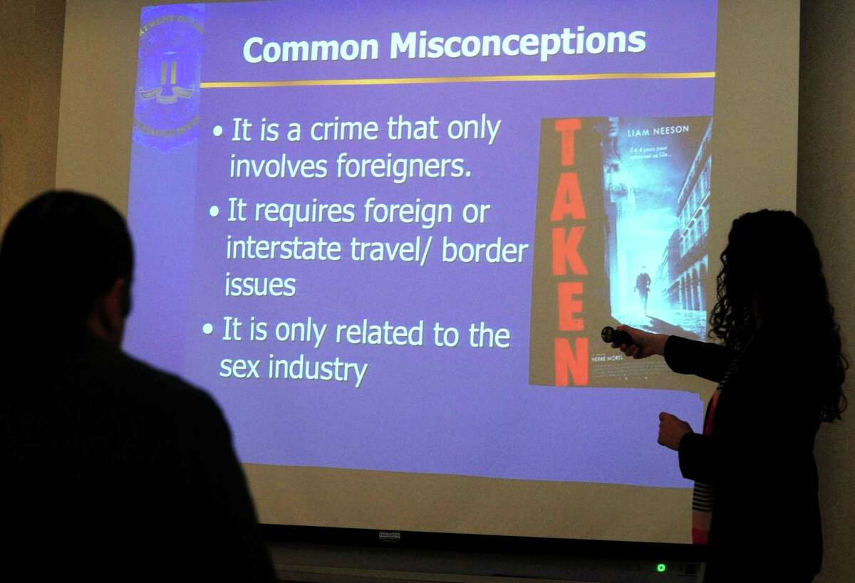 The Norwalk Police Department hosts a presentation on human trafficking Thursday, March 1, 2018, conducted by FBI Special Agent Wendy Bowersox in the Police Department Community Room in Norwalk, Conn. The department invited local hotel owners and their staff for the comprehensive overview enabling them to better identify the signs of human trafficking.