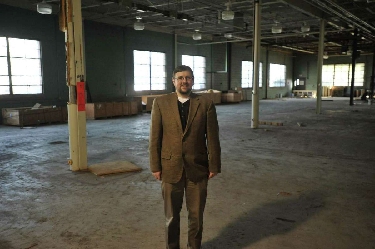 New Opportunities Inc. is planning to establish an aquaponics farm in a warehouse on Field Street in Torrington. Above, Bill Rybczyk, director of research, development and planning with New Opportunities in the currently-unused space.