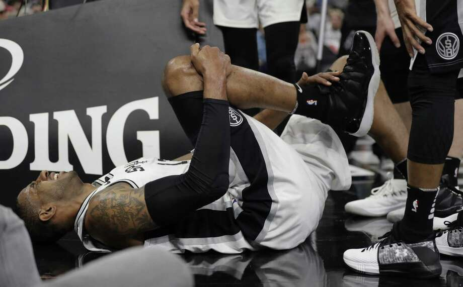 San Antonio Spurs forward LaMarcus Aldridge (12) holds his ankle after a play during the first half of an NBA basketball game against the New Orleans Pelicans, Wednesday, Feb. 28, 2018, in San Antonio. (AP Photo/Eric Gay) Photo: Eric Gay, STF / Associated Press / Copyright 2018 The Associated Press. All rights reserved.