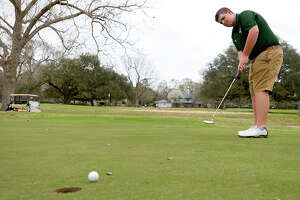 Little Cypress-Mauriceville golfer Jack Burke putts while practicing at the Sunset Grove Country Club in Orange on Tuesday afternoon.  Photo taken Tuesday 2/20/18 Ryan Pelham/The Enterprise