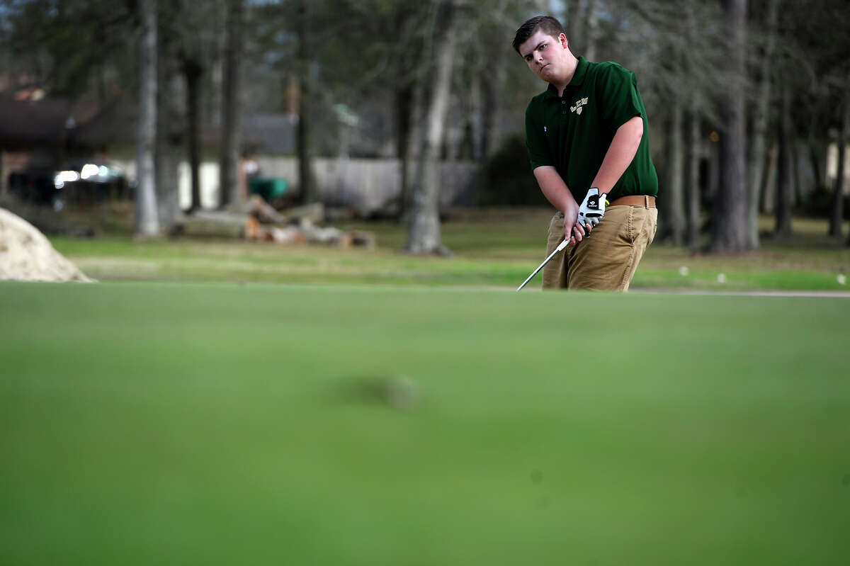 Little Cypress-Mauriceville golfer Jack Burke chips to the green while practicing at the Sunset Grove Country Club in Orange on Tuesday afternoon. Photo taken Tuesday 2/20/18 Ryan Pelham/The Enterprise
