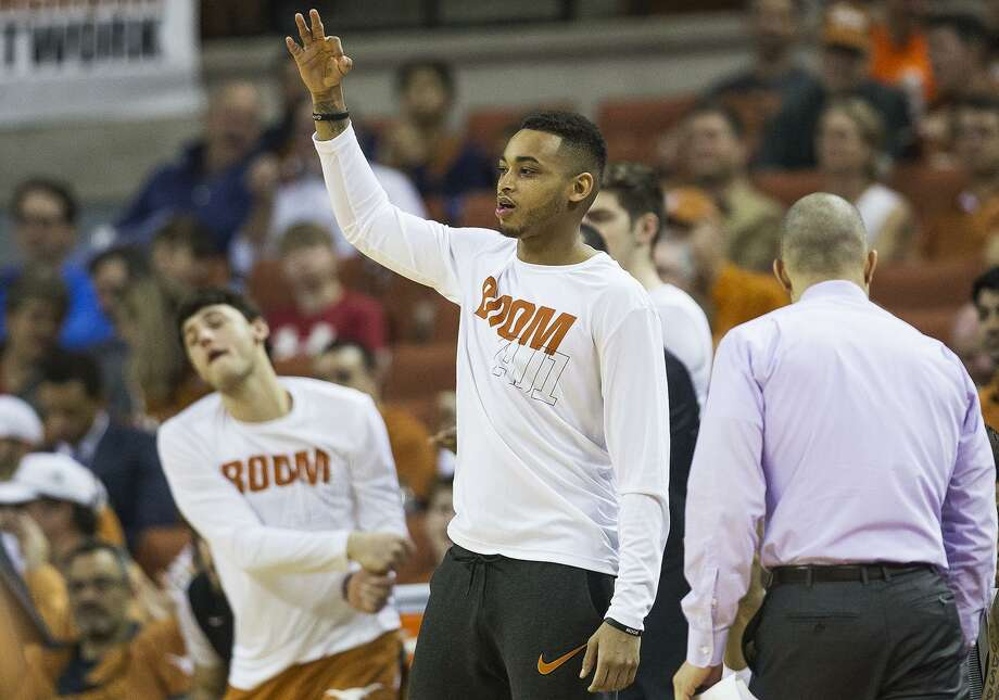 Texas guard Eric Davis Jr. celebrates a teammate's three pointer during an NCAA college basketball game against Oklahoma State in Austin, Texas, on Saturday, Feb. 24, 2018. (Nick Wagner /Austin American-Statesman via AP) Photo: Nick Wagner, MBO / Associated Press / Austin American-Statesman