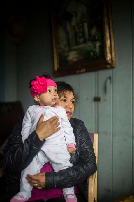 Guadalupe Manzo, Brenda Manzo-Garcia and 9-month-old Nala Manzo are left in Napa after the family patriarch, 55-year-old Jesus Manzo Ceja, was swept up in a recent ICE immigration crackdown. Photo: Brian L. Frank, Special To The Chronicle