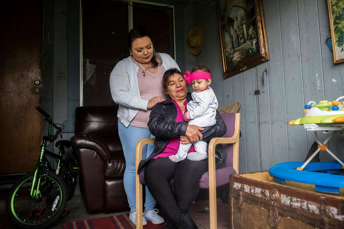 Guadalupe Manzo, Brenda Manzo-Garcia and 9-month-old Nala Manzo photographed at their family home in Napa, CA on March 1, 2018. The family patriarch, 55-year-old Napa resident Jesus Manzo Ceja, was swept up in a recent ICE immigration crackdown that resulted in some 150 Northern California immigrants being arrested.