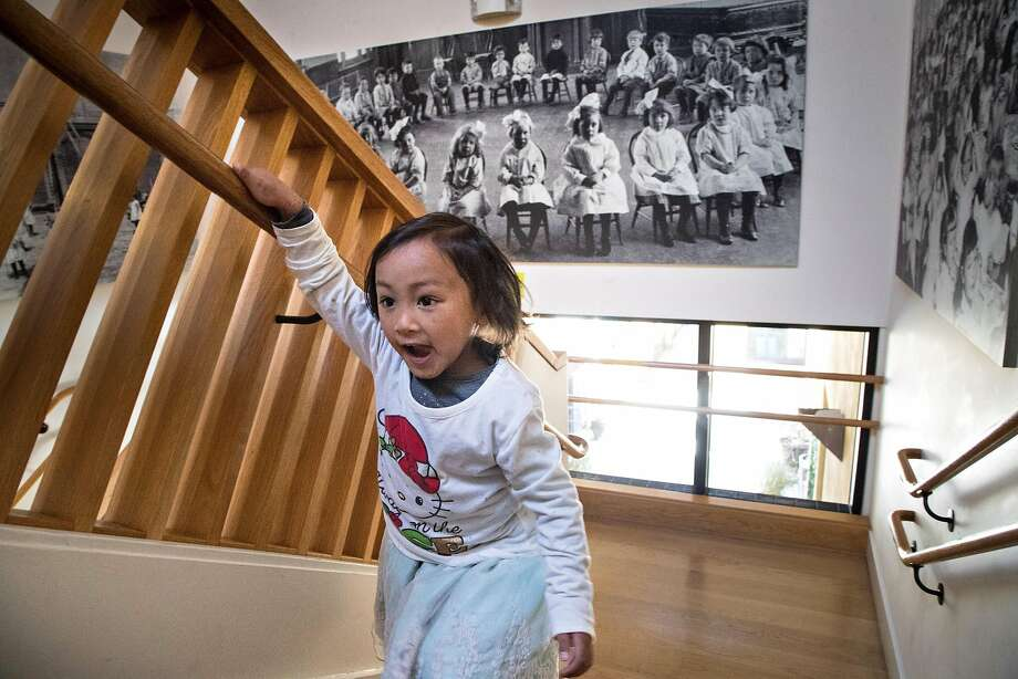 Akari Dash, 4, heads to lunch at Holy Family Day Home. A June ballot measure seeks to help families pay the costs of centers like Holy Family. Photo: Paul Kuroda, Special To The Chronicle