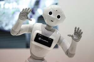 A SoftBank Group Corp. Pepper humanoid robot stands on display during day two of the Mobile World Congress (MWC) in Barcelona, Spain, on Tuesday, Feb. 27, 2018. At the wireless industry's biggest conference, more than 100,000 people are set to see the latest smartphones, artificial intelligence devices and autonomous drones exhibited by roughly 2,300 companies. Photographer: Simon Dawson/Bloomberg