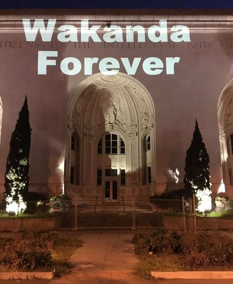 "A mysterious Oakland resident has been projecting the words ""WAKANDA FOREVER"" on Oakland landmarks including the Paramount Theatre and Henry J. Kaiser Convention Center, in celebration of the movie ""Black Panther."" Photo: Courtesy Photo"
