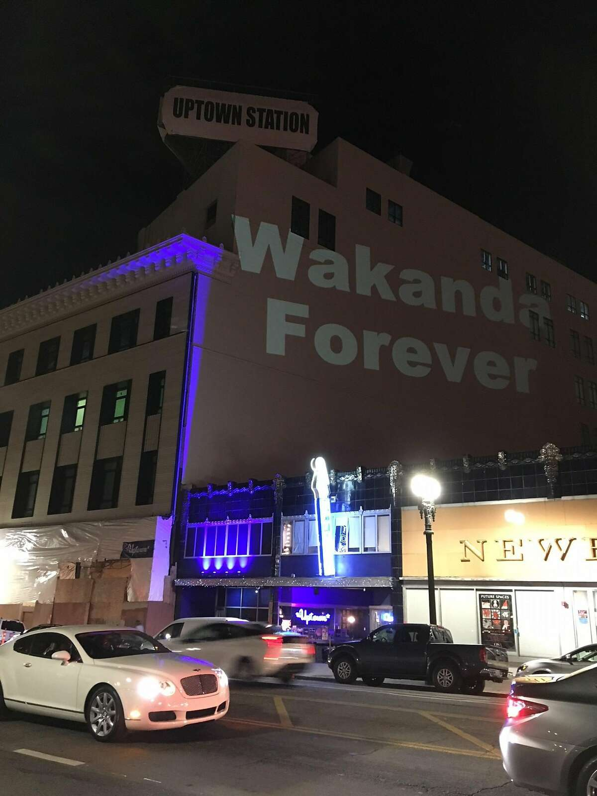 """A mysterious Oakland resident has been projecting the words """"WAKANDA FOREVER"""" on Oakland landmarks including the Paramount Theatre and Henry J. Kaiser Convention Center, in celebration of the movie """"Black Panther."""""""