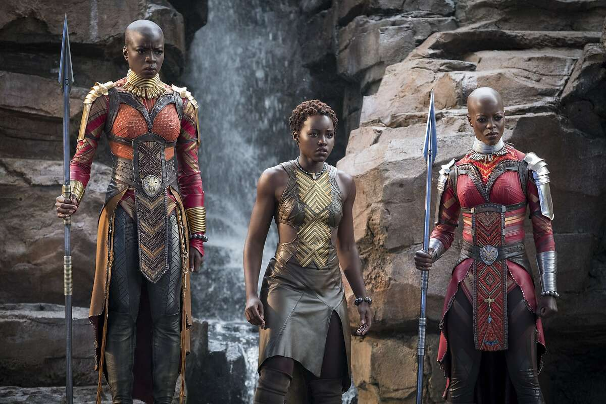 """This image released by Disney -Marvel Studios shows, from left, Danai Gurira, Lupita Nyong'o and Florence Kasumba in a scene from """"Black Panther."""" Gurira says the representation of women in """"Black Panther"""" is important for young girls to see. The film features a number of powerful female leads, including Gurira as the head of a special forces unit, Lupita Nyong'o as a spy, Angela Bassett as the Queen Mother and newcomer Letitia Wright as a scientist and inventor. (Matt Kennedy/Disney/Marvel Studios via AP)"""