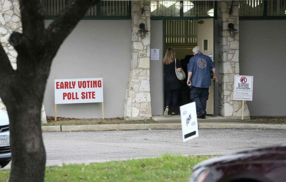 An election judge holds the door for a voter as they enter the early voting site Tuesday, Jan. 20, 2018 at the Lions Field Adult and Senior Center on the first day of early voting for the March 6 joint primary elections. Early voting happens every day through Friday, March 2 at 38 Bexar County locations. Photo: William Luther, Staff / San Antonio Express-News / © 2018 San Antonio Express-News
