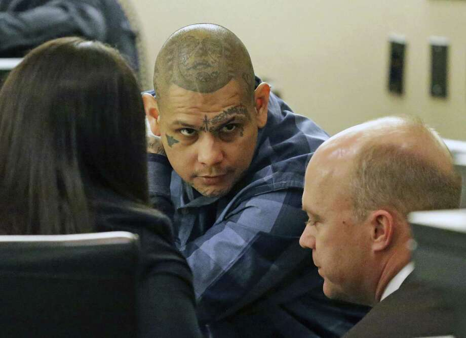 The defendent consults with his attorneys as testimony is heard on February 28, 2018 in the trial of Gabriel Moreno, accused of killing Jose Luis Menchaca. Photo: Tom Reel, Staff / San Antonio Express-News / 2017 SAN ANTONIO EXPRESS-NEWS