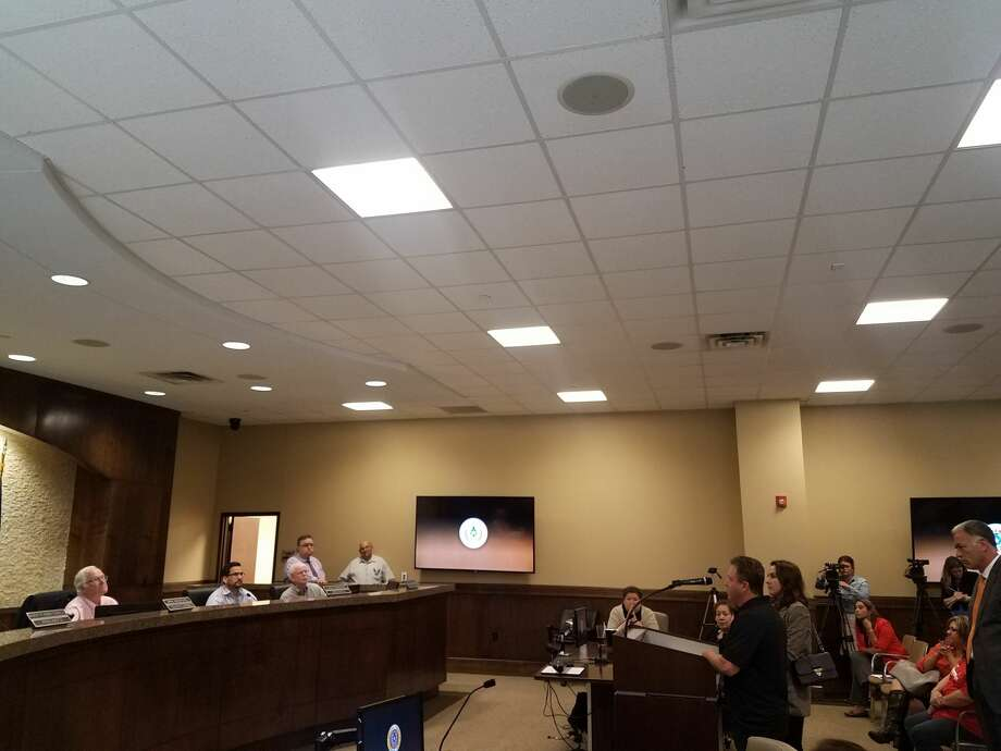 Co-Owners Silvia Herrera and Kevin Gordon along with La Hacienda attorney Israel Guardiola address the Midland County Commissioners. Photo: Mercedes Cordero/Reporter-Telegram